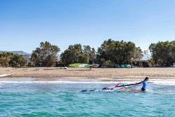 Crete windsurfing holiday. Palekastro Bay windsurf centre on the beach.