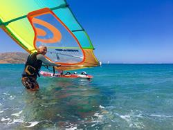 Crete windsurfing holiday. Palekastro Bay windsurf beach launch.