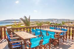 Club Anemos - Karpathos. Bar and restaurant seating, with views over the windsurf sailing area.